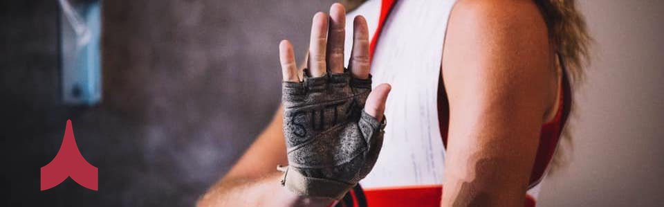 Phantom Regiment Guard member with SUTA written on glove