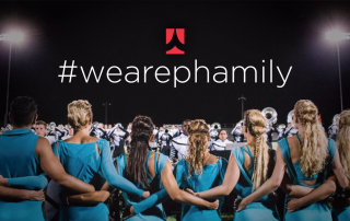 Phantom Regiment members embrace with #wearephamily