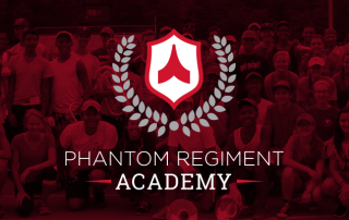 Phantom Regiment Academy logo with group shot behind red filter